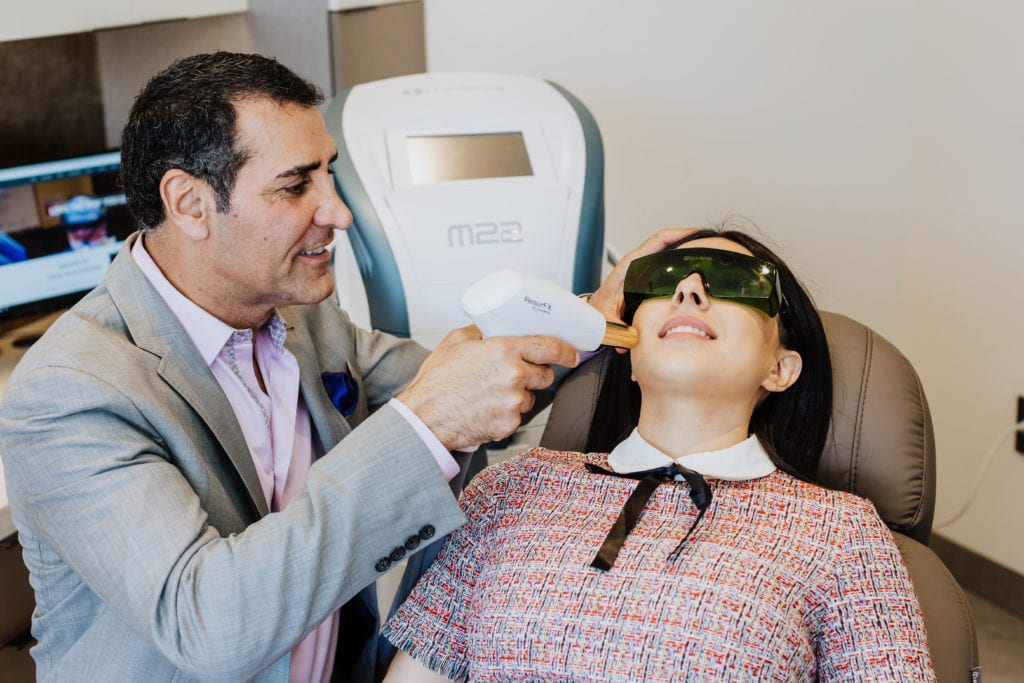 Dr. Kevin Sadati with Patient at Gallery of Cosmetic Surgery performing Laser Skin Resurfacing in Newport Beach, CA